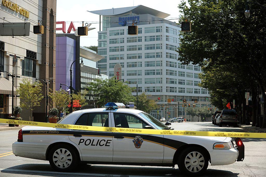A police car blocks a road near the Disc