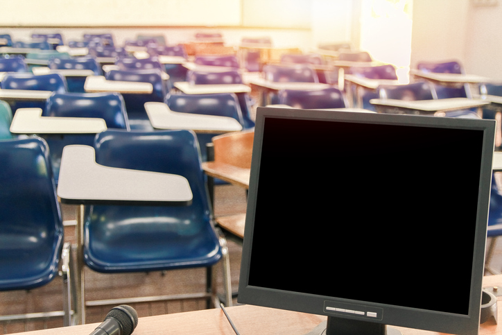 Computer On Table At Classroom