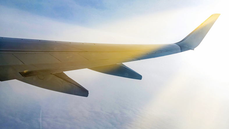 Sunset sky on airplane window