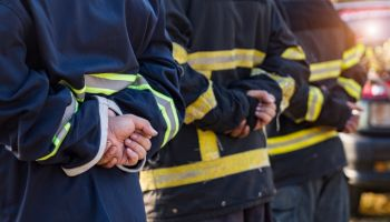 """Save to Board""""nDiverse group of fire fighters at the station"""