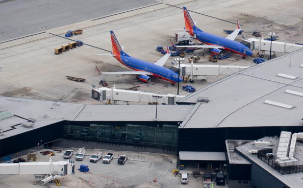 Southwest Boeing 737 airplanes sit at th