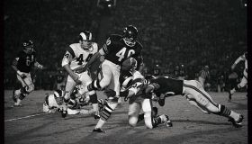 Gale Sayers Gets Hit Carrying Football